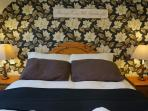Bedroom of a two bedroom Prestige Cottage
