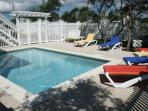 Pool Has Large Pavers Area with Seating