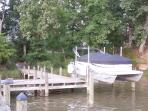 Pontoon boat seats 10 people and 2-2 seat jet skis that can be included in your vacation cost.