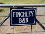 Sign on gate at entrance to Finchley B and B