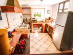 Great kitchen with a new refrigerator, counter-top oven and 6-burner, gas stove top.
