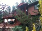 side view of the cabin, there are two bedrooms upstairs and one bedroom downstairs