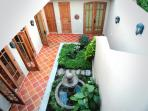 Fountain and plantings in the interior courtyard.