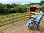 Ideal for relaxing and  watching the children in the playden . Sun loungers included :-)
