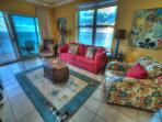 Large living room with great views of Gulf & Little Lagoon from inside & from large wrap around deck