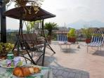 is on the terrace that our guests have breakfast and relax with a book and a cool drink .. at a home