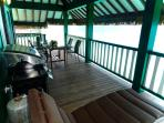 Our huge lanai has a dining area, new gas barbecue and comfy lounge chairs!