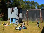 Kids cubby house with toys underneath & swing set to enjoy. Please pack up after your children. Than