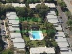 Great aerial view of Surf court where our condo is next to the pool.