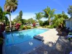 An amazing 15' x 30' heated, salt water pool makes the backyard a paradise you never want to leave.