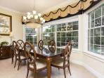 The open plan informal dining area is spacious, light and elegant