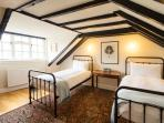 This room has two single beds and faces the front of of the cottage.