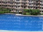 the middle  swimming pool beside  kids swimming pool