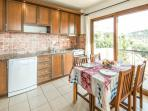 Fully equipped kitchen with balcony and access to large dining terrace