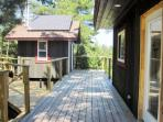 Deck from cottage to bath house with toilet and shower