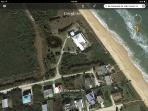 Areal view of the house.  The path to the ocean is through the two homes on the beach.