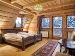 bedroom nr 4 with two single beds, bathroom and balcony