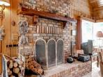 Cozy up by the floor-to-ceiling brick fireplace.
