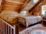 The open loft offers 2 twin-sized beds.