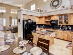 Prepare your favorite foods in the home's fully equipped kitchen, complete with granite countertops and all necessary...