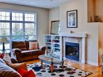 Unwind in this bright living room next to the welcoming fireplace
