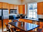 This sleek kitchen comes fully equipped with all the essential cooking appliances