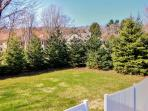 The home's very private backyard is perfect for lawn games and enjoying nature!