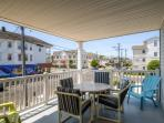 Admire beautiful views of the beach, boardwalk, and downtown while dining al fresco on the unit's large private deck.