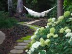 Relax in a cozy hammock as you take in the sound of the babbling creek below.