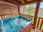 Soak in your own private hot tub with these expansive views!
