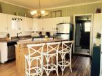 Equipped kitchen and breakfast nook kitchen island. Adjacent washroom and laundry.