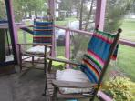 Comfy rocking chairs, along with wicker chaise for napping and wicker side chairs