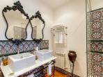 stunning hand crafted marble sinks and hand painted tiles in the ensuite shower room