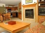 View of living room into kitchen Tamaracks 2 Bedroom Unit