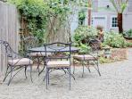 Well Maintained Garden. Wrought Iron Chairs. Teak Deck Chairs. Enjoy Morning Coffee.