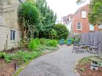 Well Maintained Garden. Wrought Iron Table & Chairs. Teak Deck Chairs. Relax and Enjoy!