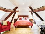 The bedroom with exposed beams