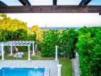 Villa view from 1st  floor pool, garden & sea