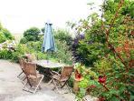 terrace sunny till mid afternoon, overlooks garden