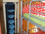 Adult sized bunk beds in smaller room most suitable for young adolescents or children.