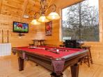 Second floor game room with pool table, TV, arcade