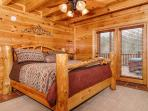 Downstairs West bedroom, rustic log bed, electric fireplace