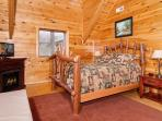Upstairs East Bedroom with rustic sassafras queen bed & twin daybed, fireplace