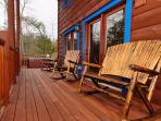 Ample decks with rocking chairs and loveseats