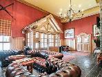 Reception area with sofas around a log fireplace