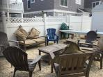 Ground view of back yard.  Seating for 6+ at teak outdoor living room. Shade umbrellas available.