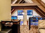 Loft area with game table and arcade