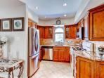 Prepare your favorite home-cooked meals in this bright fully equipped kitchen.