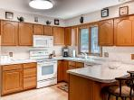 The fully equipped kitchen comes with everything you need to prepare your favorite meals.