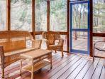 The screened porch is the perfect place to admire the wooded views.